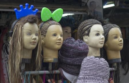 braiding: Mannekin heads displaying types of hair braiding on Khao San Road, Bangkok