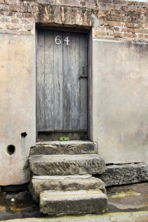 Steps leading up to an old door with the number 64 in the Rocks district of Sydney, Australia photo