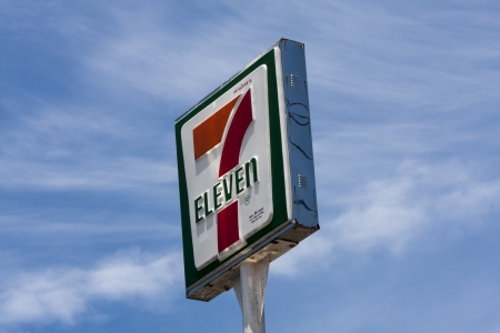 eleven: THALANG, PHUKET, THAILAND-MAY 13TH 7 Eleven sign on blue sky background  There are almost 700   Eleven stores in Thailand, half of which are in Bangkok