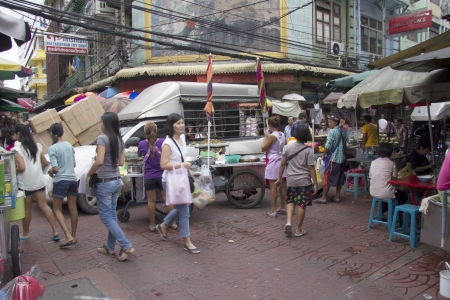 bustling: BANGKOK, THAILAND- OCT 10TH  Bustling Chinatown in Bangkok on October 10th 2012  Chinatown is one of the oldest areas of the city  Editorial