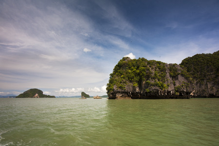 Koh Phanak and the green waters of Phang Nga Bay, Thailand photo