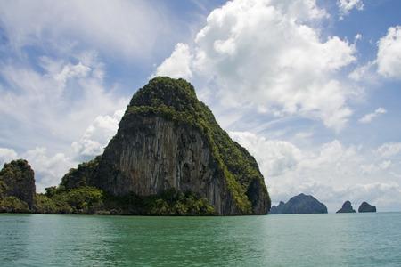 The green waters of Phang Nga Bay, Thailand photo