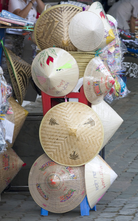 non la: Hats for sale outside a shop ion Ho CHi Minh City