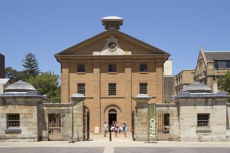 SYDNEY, AUSTRALIA-December 19th 2913  Tourists leaving the Hyde Park Barracks Museum  The building was built in 1819 originally to house convict men and boys  Stock Photo - 26218205