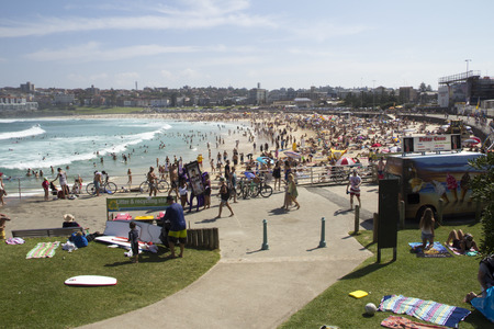 bathers: Sydney, Australia-March 16th 2013: Bondi Beach viewed from the north on a busy holiday weekend. The beach is one of Australias most famous and is listed in the Australian National Heritage List.