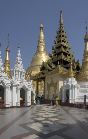 reputed: Yangon, Myanmar-May 6th 2014: People stroll through the Shwedagon Pagoda complex.Some structures are reputed to be 2,500 years old. Editorial
