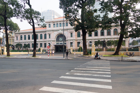 ouside: Ho Chi Minh City, Vietnam-29th Oct 2013: Early morning ouside the Central Post Office. The building was designed by the architect Gustav Eiffel in the early 20th century.