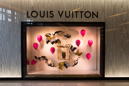louis vuitton: Bangkok, Thailand-Nov 25th 2014: Louis Vuitton store in Siam Paragon Mall. The mall is home to many designer labels.