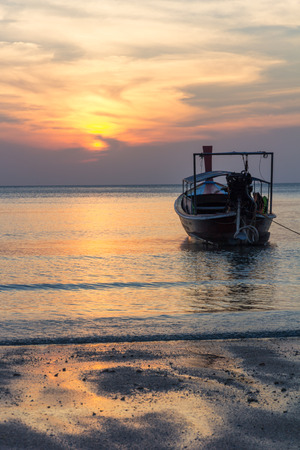 nam: Boat at sunset on Pak Nam beach, Trang Province, Thailand