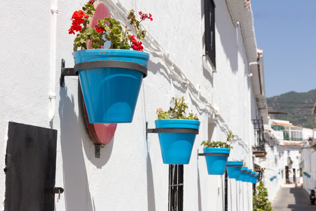 andalucia: Blue plantpots against whitewashed walls in Mijas, Andalucia, Spain