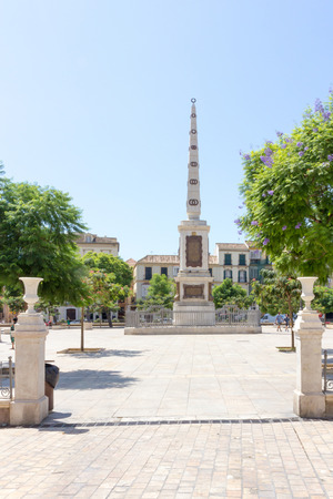 recreational area: Malaga, Spain-August 26th 2015: Monument in the Plaza de la Merced. The square is a popular recreational area during the day.