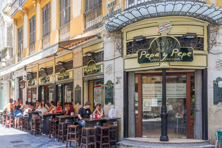 al fresco: Malaga, Spain-August 26th 2015: People eating outside the Pepa y Pepe restaurant. Al fresco dining is very popular both at lunchtimes and evening.