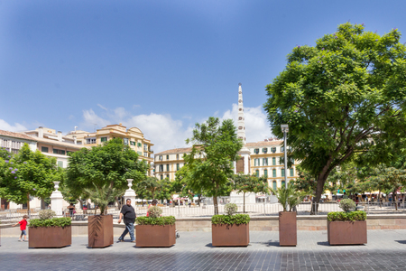 recreational area: Malaga, Spain-August 26th 2015: People walking past the Plaza de la Merced. The square is a popular recreational area. Editorial