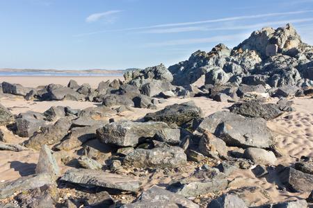 volcanic: Volcanic rocks on Newborough Beach, Anglesey, Wales