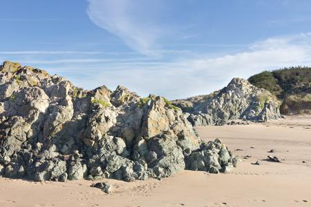 volcanic: Volcanic rock on Llanddwyn Island, Anglesey, Wales Stock Photo