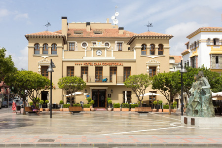 queen isabella: The Hotel Casa Consistorial in Plaza de los Reyes Catlicos with the statue of the Catholic King Ferdinand and Queen Isabella