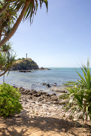 pandanus tree: Koh Lanta lighhouse with rocky beach in the foreground
