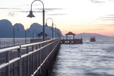 sunup: Khlong Kian Pier and boat, Phang Nga Province, Thailand at dawn