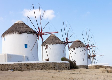 myconos: Mykonos windmills against a bright blue sky