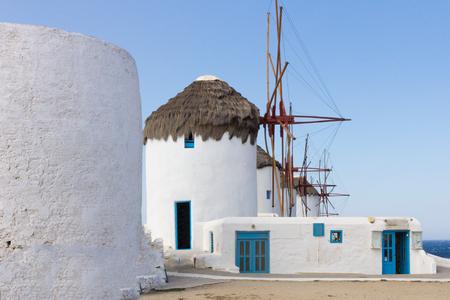 myconos: Windmills in Mykonos , Greece against a bright  blue sky