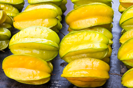 Yellow starfruit (Carambola) for sale on a market stall, Bangkok, Thailand