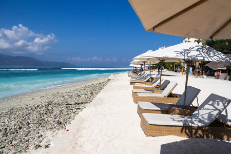 Chairs and umbrellas on a white sand beach, Gili Trawangan, Indonesia