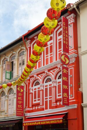 Singapore - 4th April 2017: Colourful travel agent in Chinese shophouse in Temple street, Chinatown. Many chinese shophouses have been restored. Editorial