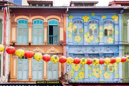 Singapore - 4th April 2017: Colourful Chinese shophouses and lanterns in Pagoda street, Chinatown. Many chinese shophouses have been restored.