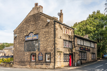 Uppermill, Oldham, UK - September 21st 2010: The White Lion public house. The village sits on the border between Lancashire and Yorkshire.