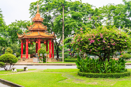 Bangkok, Thailand - April 25th 2011: Chinese pavilion in Lumphini Park. This is the largest green space in the city.