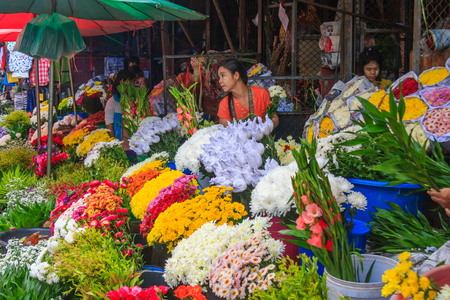 Mae Sot, Thailand - November 20th 2011: Flower stall, market. The town is close to the Burmese border. Редакционное