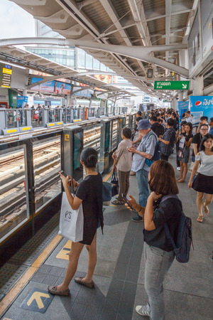 Bangkok, Thailand - March 10th 2017: Passengers waiting for  the skytrain at Asoke station. This is one of the busiest stations as it connects with the MRT.