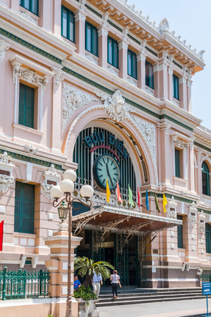 Ho Chi Minh City, Vietnam-February 25th 2010: Front entrance to the Saigon Central Post Office. The building was completed in 1891 and designed by Gustave Eiffel. Publikacyjne