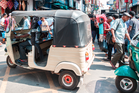 Colombo. Sri Lanka - December 21st 2016: A tuk tuk makes its way down a street in the Pettah district. This is the main commercial area.