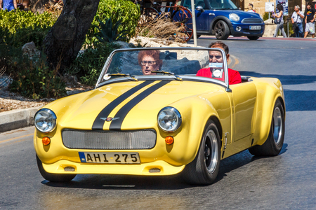Valetta, Malta - September 13th 2015: A classic Austin Healey Sprite convertible sports car on the road. The car was produced bween 1958 and 1971. Editorial