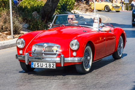 Valetta, Malta - September 13th 2015: A classic MGA convertible sports car on the road. The car was produced bween 1955 and 1962.