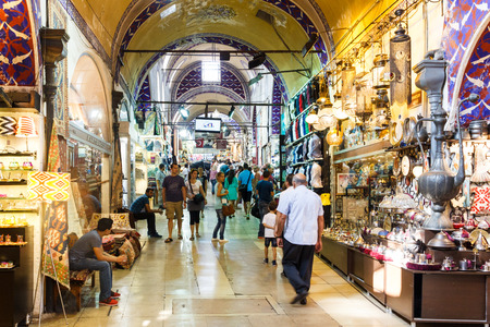 Istanbul, Turkey - September 21st 2015: People shopping in the Grand Bazaar. Many stalls sell souvenirs to tourists.