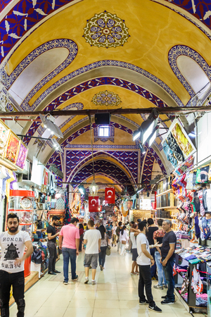 Istanbul, Turkey - September 21st 2015: People shopping in the Grand Bazaar. Many stalls are full of souvenirs sold to tourists. 에디토리얼