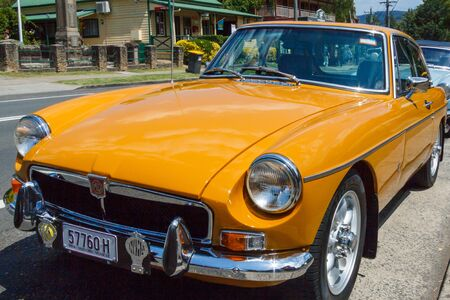 Kangaroo Valley, Australia - 7th February 2018: Classic yellow MGB GT roadster sports car. Thq car was produced between 1963 and 1980.