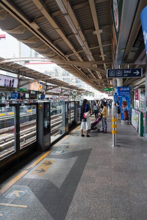 Bangkok, Thailand = 20th March 2018: People waiting on the platform for the Skytrain, Chidlom station. The skytrain is an integral part of the citys transport system.