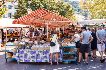 Nice, France - September 9th 2015 : Tourists in the old town market. The market is open every day except Monday.