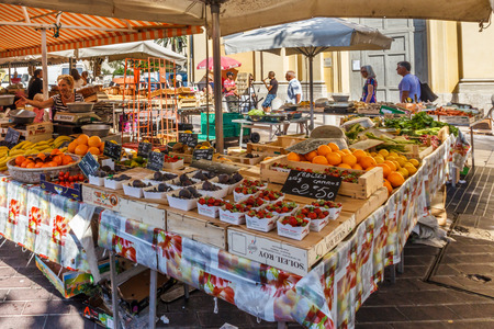 Nice, France - September 9th 2015: Tourists in the old town market. The market is open every day except Monday.