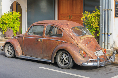 Phuket, Thailand - January 13th 2012: Old Volkswagen Beetle car in  Phuket, Town. The car has iconic status all over the world.