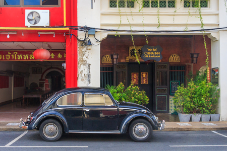 Phuket, Thailand - January 13th 2012: Old Volkswagen Beetle car outside China Inn cafe, restaurant in old Phuket Town. The car has iconic status all over the world.