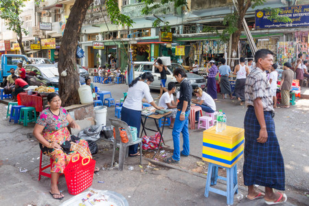 Yangon, Myanmar - May 4th 2014: Street scene. The streets are always a hive of activity.