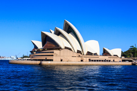 Sydney, Australia - March 13th 2013: View of the Opera House in Sydney Harbor. The Central Business District is in the background. Editorial