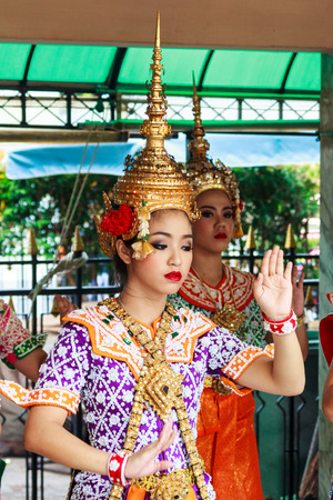 Bangkok, Thailand - September 27th 2014: Beautiful dancer at the Erawan shrine. People pay to have the troupe dance when they have had good luck