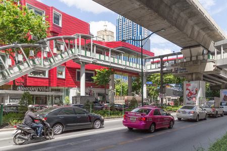 Bangkok, Thailand - June 14th 2016: Skytrain and pedestrian bridge at Chit Lom. The Skytrain is an integral part of the public transport system.