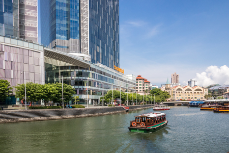 Singapore - July 8th 2019: The Singapore river at Clarke Quay. The river flows through the city centre.