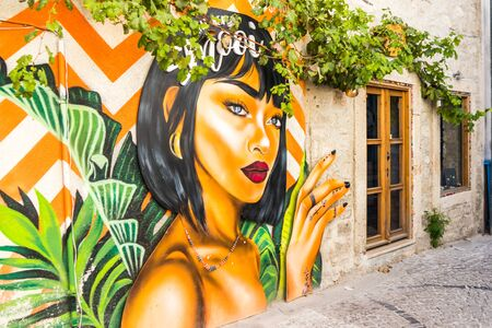Alacati, Turkey - September 7th 2019: Wall mural on side of a building. The town is popular with tourists in summer